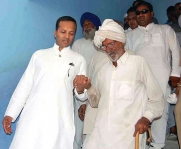 <h5>Naveen Jindal helping a senior citizen at a Health Camp</h5>