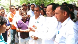 <h5>Naveen Jindal with constituents at a Health Camp</h5>